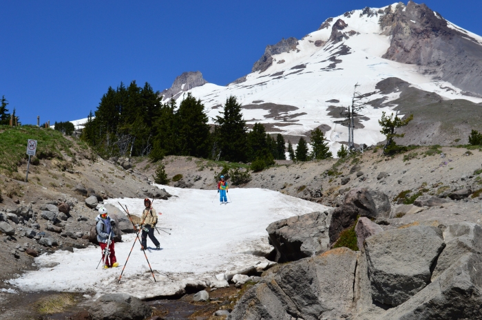 Skiers at Timberline in front of Mt Hood