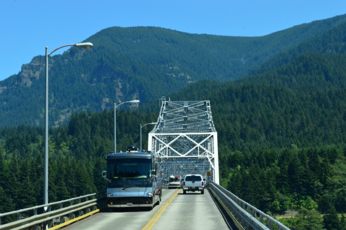 Two big RVs passing on a very narrow bridge